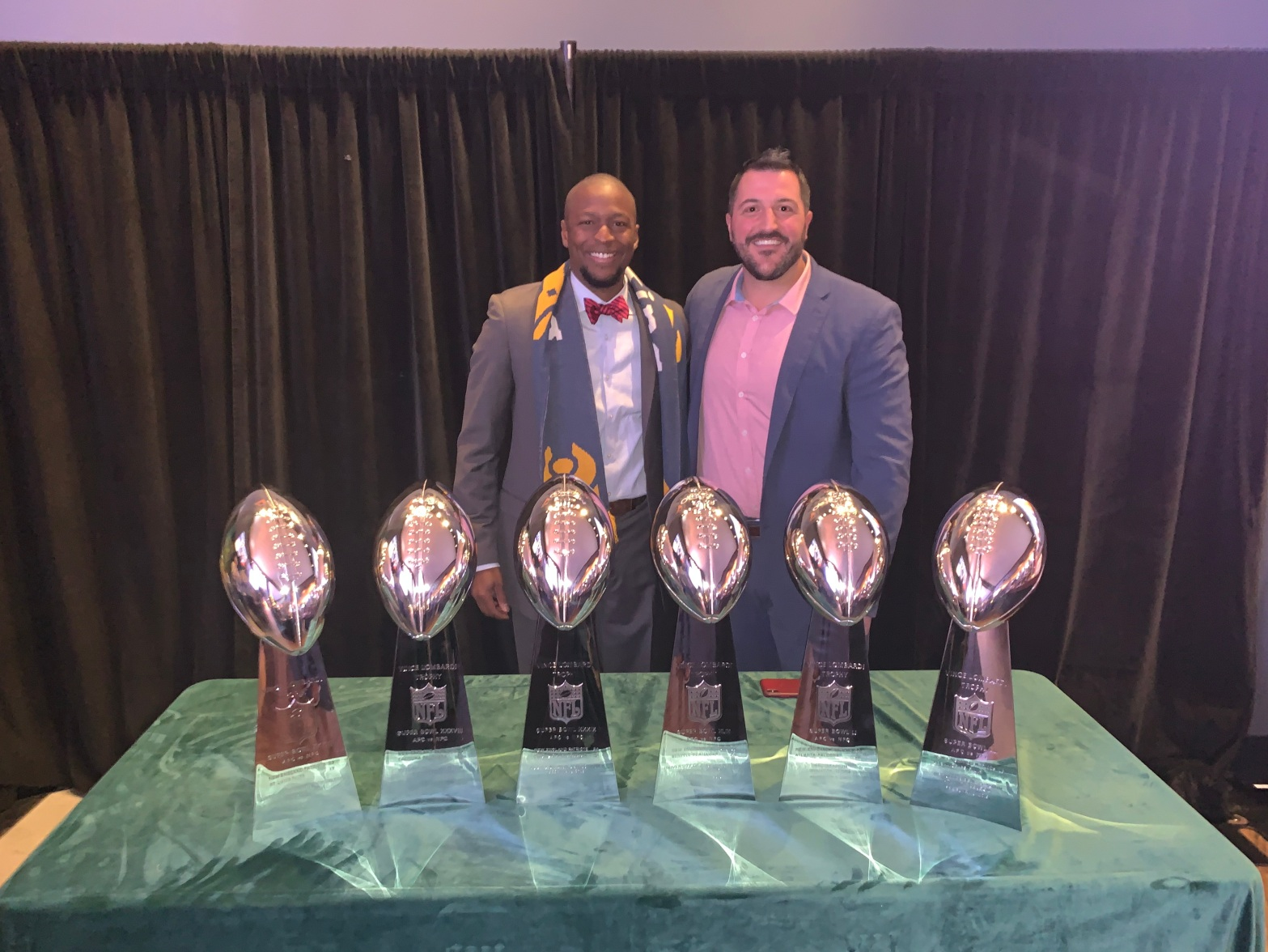 LeRoy Watkins with the Patriots super bowl trophies